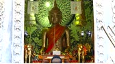 blessed : Buddhists come to pay respect to the Buddha statues in the temple Stock Footage