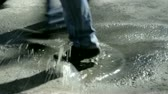 asphalt : feet of the crowd on the sidewalk in a pool of reflection Stock Footage