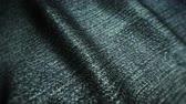 shimmers : Realistic jeans waving in the wind. Abstract background Ultra-HD resolution. Close-up fabric texture. Seamless loop. Stock Footage