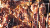 barbequed : chicken legs grilled on grill close-up outdoors