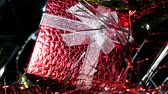 noel kartı : Christmas red gift box. Beautiful gifts under the tree. New years interior. Christmas tree, happy holidays. Christmas spirit, holidays and celebrations concept Stok Video