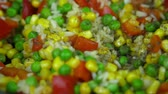 rice pan : On the vegetable mix pepper is poured. Stock Footage