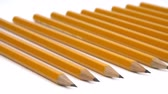вести : A row of pencils on a white surface