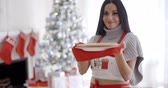 smell : Young woman baking Christmas treats Stock Footage