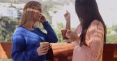 patio : Young women chatting on an open-air patio