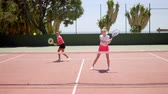 çiftler : Two young woman tennis doubles players