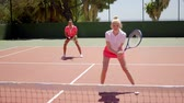 çiftler : Two pretty women playing a game of tennis doubles