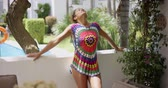 patio : Beautiful woman in colorful knit top on balcony