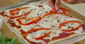 pieczarka : Woman make a tasty traditional homemade pizza