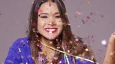blow : Cute young woman blowing confetti