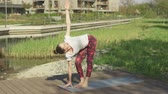 nilüfer : Glorious female practicing yoga on exercise mat in nature near house