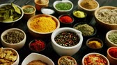 curry : From above view of many little bowls with different kinds of spices laid on wooden background