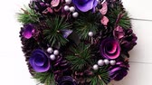 pinha : Purple Colored Christmas Wreath on White Wooden Background, Top View, Flat Lay, Winter Holidays Concept. Stock Footage