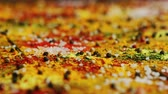 curry : Closeup shot of various fresh spices spilled on surface of timber tabletop in kitchen