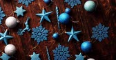 nowe mieszkanie : From above shot of various Christmas decorations of blue color lying on scratched lumber tabletop