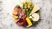 Çedar : Assortment of spanish tapas or italian antipasti with meat, ham, olives, cheese, nuts and bread placed on a white rusty table. Top view flat lay with copy space background