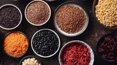 mercimek : Various superfoods in smal bowls on dark rusty background. Superfood as rice, lentil, beans, peas, goji, flaxseed, buckwheat, couscous, chickpeas Top view Flat lay