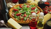 салями : Italian food background with pizza, raw pasta, spices, herbs, wine, and vegetables on wooden table