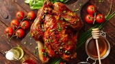 Roasted whole chicken or turkey served on wooden chopping board with chilli pepers and chive. With ingredients on sides. Shot from above with copy space for text.