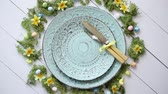 rozmaring : Easter table setting with flowers and eggs. Empty decorative ceramic plates. Rustical dishware. View from above.