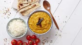 cominho : Indian popular food Dal fry or traditional Dal Tadka Curry served in ceramic bowl with rice and naan bread. Placed on white wooden table. Closeup view over.