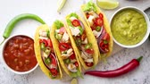 çili : Delicious Mexican fresh crispy tacos are served on wooden board. Stuffed with grilled chicken, spicy pepper, onion, tomato and more. With salsas on side.