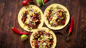 view from above : Healthy corn tortillas with grilled beef, fresh hot peppers, cheese, tomatoes over rusty wooden table background, top view, copy space. Mexican food contept.