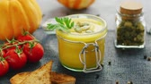 chayote : From above view of glass jar with pumpkin soup surrounded by fresh tomatoes and bread placed on textile napkin