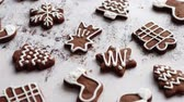 cannella : Composition of delicious gingerbread cookies shaped in various Christmas symbols. Placed on white rusty table. Top view.