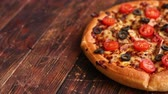mussarela : Pizza pepperoni with mozzarella cheese, tomato sauce, salami, black olives, cherry tomatoes. American style pizza on brown rusty wooden table background.