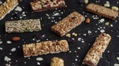 tohumlar : Mixed gluten free granola cereal energy bars. With dried fruits and nuts. Placed on black stone background. Healthy vegan super food. Fitness dieting snack for sporty lifestyle. Top view.
