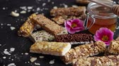 tohumlar : Healthy superfood composition. Various kinds granola energy protein bars with honey in jar on site. Flat lay with copy space.