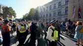 протест : LONDON - SEPTEMBER 20, 2019: Police passing The Cenotaph ahead of an Extinction Rebellion march on Whitehall, London Стоковые видеозаписи