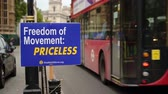 democrático : LONDON - OCTOBER 23, 2019: Brexit protest sign with London bus and black cab passing the Houses of Parliament