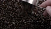напиток : Roasted Coffee beans poured from a metal measuring scoop 1
