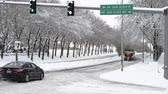 clareira : HILLSBORO, OREGON JANUARY 11 2017, Snowplow trucks going down a road working together to clear two lanes at once, cars following them.