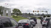 SURREY, BRITISH COLUMBIA, JUNE 10 2017, Cars waiting to advance at the Peace Arch Border Crossing between Blaine, Washington and Surrey, British Columbia on the border between United States and Canada Stock Footage