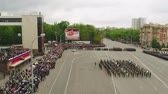 haki : MOSCOW - MAY 09: Celebration of anniversary of the Victory Day WWII on May 9, 2017 in Moscow, Russia. Military equipment, tanks and soldiers. Aerial view on military parade