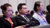 congresso : DUBAI, UAE - OCTOBER 12, 2017: World blockchain, Business group Listening To Presentation At Conference. Businesspeople Listening to Presentation