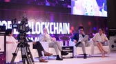 hall : DUBAI, UAE - OCTOBER 12, 2017: World blockchain, Speakers Giving a Talk at Business Meeting. Audience in the conference hall. Business and Entrepreneurship. Speakers at Business Conference and Presentation