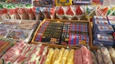 szafran : SPAIN, BARCELONA - April , 2018: Show-window with sweets and olive oil in the Boqueria market. Stock. Shop with sweets and Souvenirs Wideo