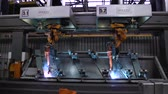Welding robots movement in car factory. Scene. Movement of robot when welding with sparks at factory of auto parts