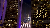 Singapore - 25 September 2018: Flying through the towers of Marina Bay Sands to the beautiful night cityscape and the river of Singapore. Shot. Aerial view from Marina Bay Sands Hotel and Singapore at night. Стоковые видеозаписи