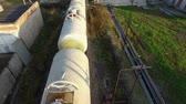gasoline tank : Russia, Moscow - 25 September 2018: Top view of set of tanks with oil and fuel transport by rail. Stock. Cistern of oil on the rails on blue sky and green field background.