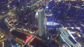 поднятый : AERIAL shot of Modern buildings and urban cityscape at night,Tianjin,China Стоковые видеозаписи