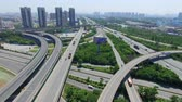 поднятый : Xian, China,16 May 2017,AERIAL shot of traffic moving on overpasses,Xian,China.