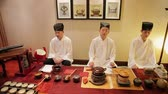 tea bowl : Beijing - NOV 01: Men dressed in traditional Chinese costume. People performing Chinese ancient tea ceremony , Nov 01, 2014,Beijing city, China Stock Footage