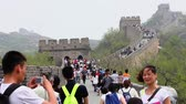 badaling : BEIJING, CHINA - MAY 08, 2013 -Tourists walking up and down the stairs of the Great Wall , May 08, 2013, Beijing, china.