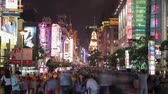 nişan : SHANGHAI - SEP 06, 2013:Timelapse of Crowds on Nanjing Road, Sep 06, 2013, Shanghai city, china. Stok Video
