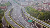 поднятый : Timelapse of busy traffic over overpass in modern city , Shanghai, China